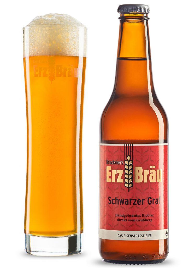 Bruckners Erzbräu Schwarzer Graf mit Glas